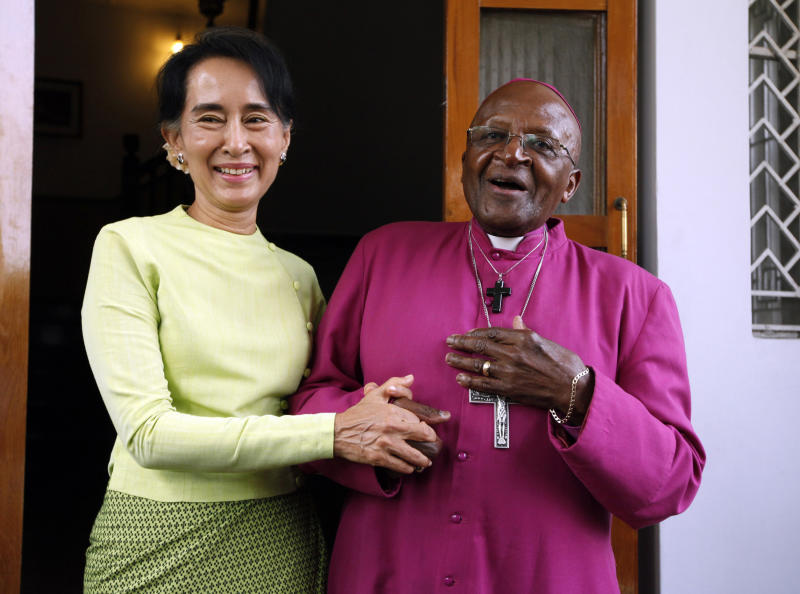 FILE - In this Feb. 26, 2013, file photo, South African Archbishop Desmond Tutu, right, and Myanmar opposition leader Aung San Suu Kyi speak during a press briefing after the Nobel laureates' meeting at her residence in Yangon, Myanmar. As the magnitude of the Rohingya tragedy emerged, 1984 Nobel Peace laureate Archbishop Desmond Tutu felt compelled to appeal to Suu Kyi. (AP Photo/Khin Maung Win, File)