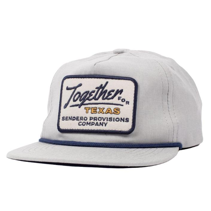 """Proceeds support Texans in need through Meals on Wheels.<br> $30, Sendero Provisions Co. <a href=""""https://senderopc.com/products/together-for-texas-hat?_pos=3&_sid=06930e227&_ss=r"""" rel=""""nofollow noopener"""" target=""""_blank"""" data-ylk=""""slk:Buy Now"""" class=""""link rapid-noclick-resp"""">Buy Now</a><br>"""