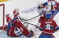 New York Rangers' Jacob Trouba, right, moves in on Montreal Canadiens goaltender Carey Price as Canadiens' Ben Chiarot defends during the second period of an NHL hockey game Saturday, Nov. 23, 2019, in Montreal. (Graham Hughes/The Canadian Press via AP)