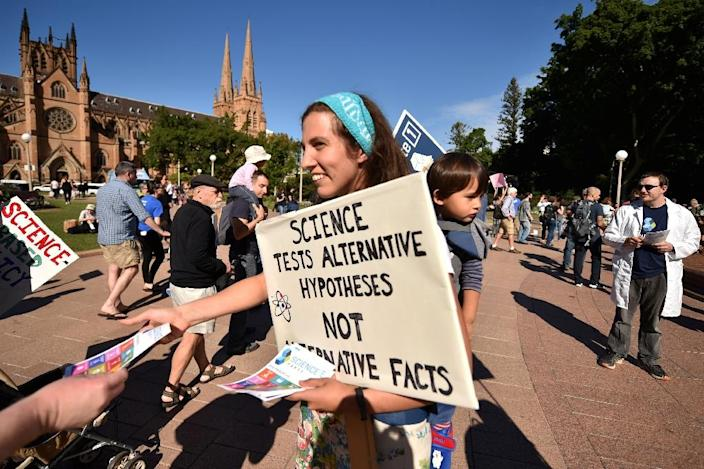 Supporters of science and research prepare to hand out leaflets as part of the March for Science protest in Sydney (AFP Photo/Peter PARKS)