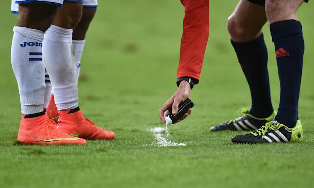 FIFA adopted the use of a biodegradable foam to help combat encroachment at free-kicks at the World Cup (AFP Photo/Rodrigo Arangua)