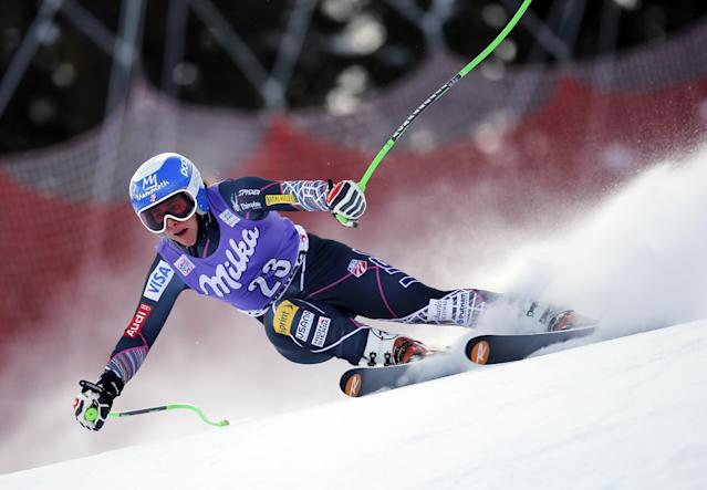 Stacey Cook of the Unites States speeds down the course to take the 13th place at an alpine ski, women's World Cup super-g, in Cortina d'Ampezzo, Italy, Sunday Jan. 26, 2014. (AP Photo/Marco Trovati)