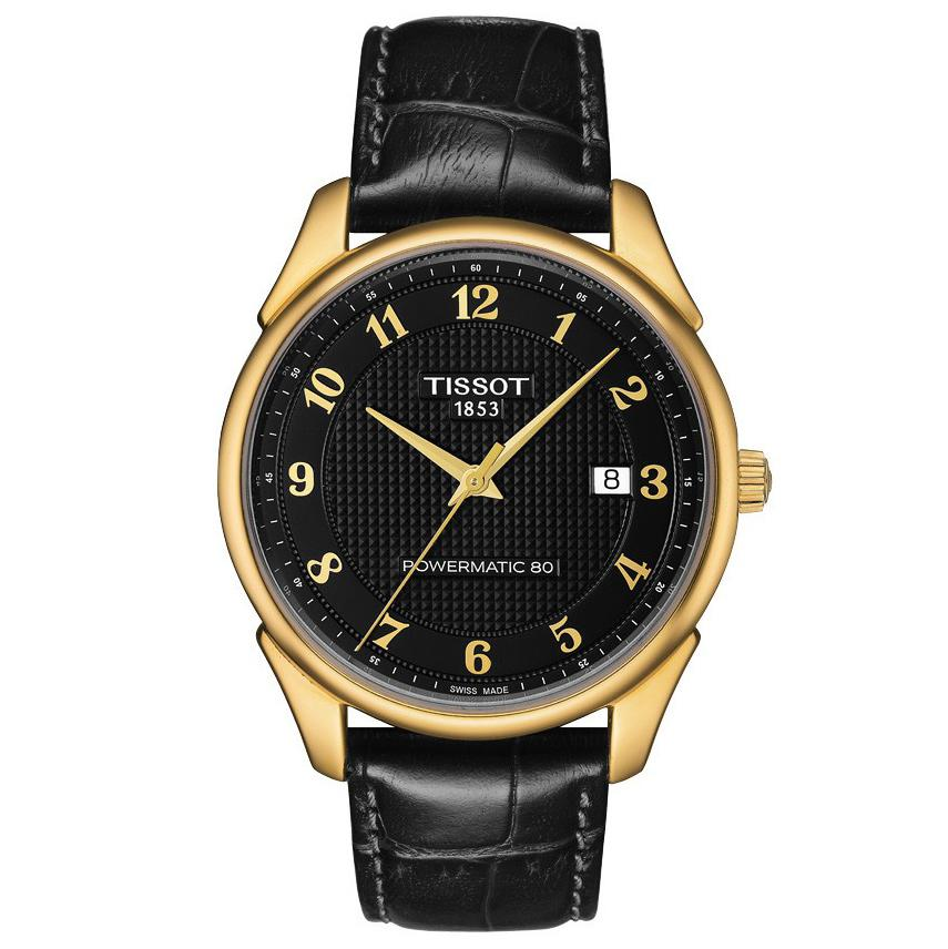 "<p>This black-and-gold watch layers well with minimalist gold bangles.</p> <p>$2950 | <a rel=""nofollow"" href='http://us.tissotshop.com/men/gold-watches/tissot-vintage-powermatic-80-18k-yellow-gold-black-dial-men-s-watch-with-black-leather-strap.html'>tissotshop.com</a></p>"