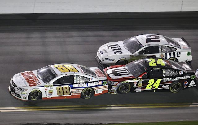 FILE - In this Feb. 23, 2014, file photo, Dale Earnhardt Jr. (88) gets a push from teammate Jeff Gordon (24) as Brad Keselowski (2) makes a run on a green flag restart on the next to last lap of the Daytona 500 NASCAR Sprint Cup Series auto race at Daytona International Speedway in Daytona Beach, Fla. Gordon and his Hendrick Motorsports teammates take up three of the top-five spots in the Sprint Cup standings. Keselowski, who picked up his third win of the season last week, is ranked third and eager to make a run at another Sprint Cup championship. It's shaping up to be a Hendrick vs. Team Penske rivalry down to the wire. (AP Photo/John Raoux, File)