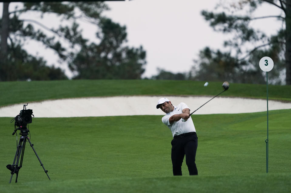 Francesco Molinari, of Italy, tees off on the third hold during the first round of the Masters golf tournament Friday, Nov. 13, 2020, in Augusta, Ga. (AP Photo/David J. Phillip)