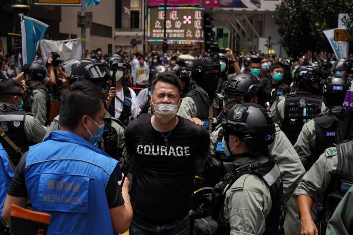 Andrew Wan, a pro-democracy lawmaker, is arrested by riot police during a protest in Hong Kong on July 1, 2020. | Yat Kai Yeung—NurPhoto/Getty Images
