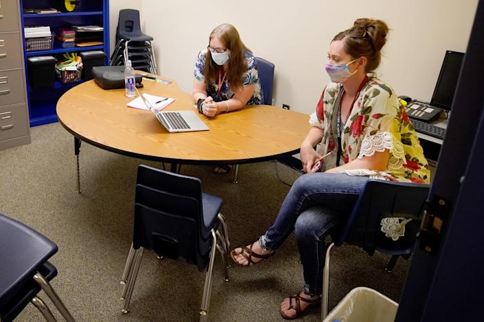 Teachers participate in a school Zoom meeting, to social distance, at Freedom Preparatory Academy as they begin to prepare to restart school after it was closed in March due to COVID-19 on August 5, 2020 in Provo, Utah. (Photo by George Frey/Getty Images)
