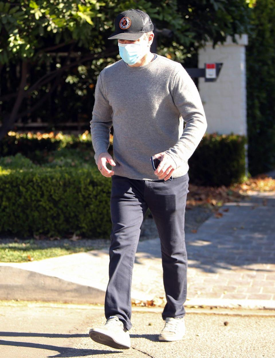 <p>A masked Matt Damon makes his way through Los Angeles on Wednesday.</p>