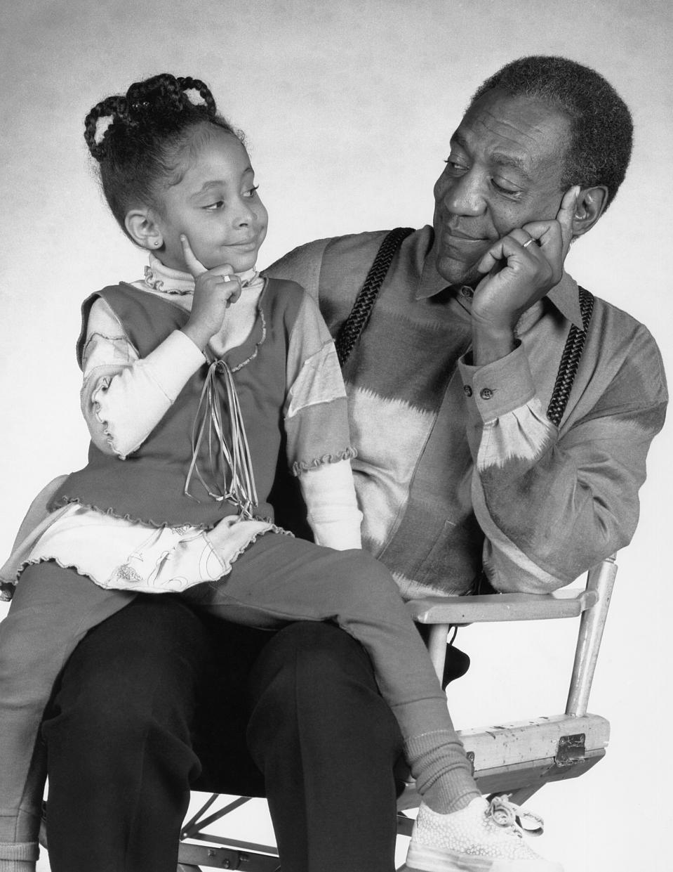 THE COSBY SHOW -- Season 7 -- Pictured: (l-r) Raven-SymonT Pearman as Olivia Kendall, Bill Cosby as Dr. Heathcliff 'Cliff' Huxtable  (Photo by Alan Singer/NBCU Photo Bank/NBCUniversal via Getty Images via Getty Images)