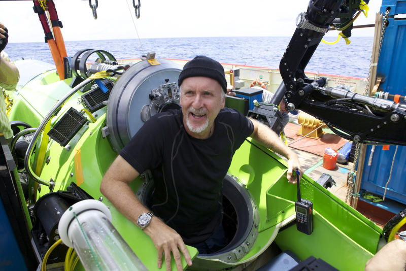 Filmmaker and National Geographic Explorer-in-Residence James Cameron emerges from the Deepsea Challenger submersible after his successful solo dive to the Mariana Trench, the deepest part of the ocean, Monday, March 26, 2011. The dive was part of a joint scientific expedition by Cameron, the National Geographic Society and Rolex to conduct deep-ocean research. (AP Photo/Mark Theissen, National Geographic)