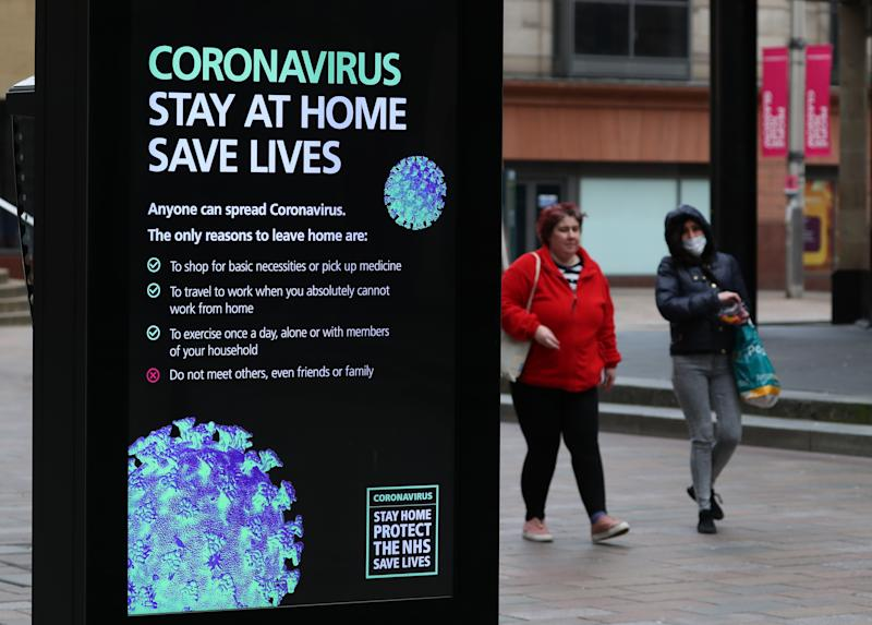 Coronavirus warnings on signs in Glasgow as the UK continues in lockdown to help curb the spread of the coronavirus. (Photo by Andrew Milligan/PA Images via Getty Images)