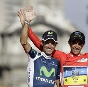 Spanish cyclists Alejandro Valverde, left, Alberto Contador, center and Joaquin Rodriguez, right, wave supporters as they celebrate at the final podium of the Spanish Vuelta cycling race after riding the final stage along 115 km (71 miles) from Cerdedilla to Madrid, on Sunday, Sept. 9, 2012. This is the second time Contador wins the Spanish vuelta, who also has a pair of Tour de France and one Giro d'Italia. (AP Photo/Alberto Di Lolli)