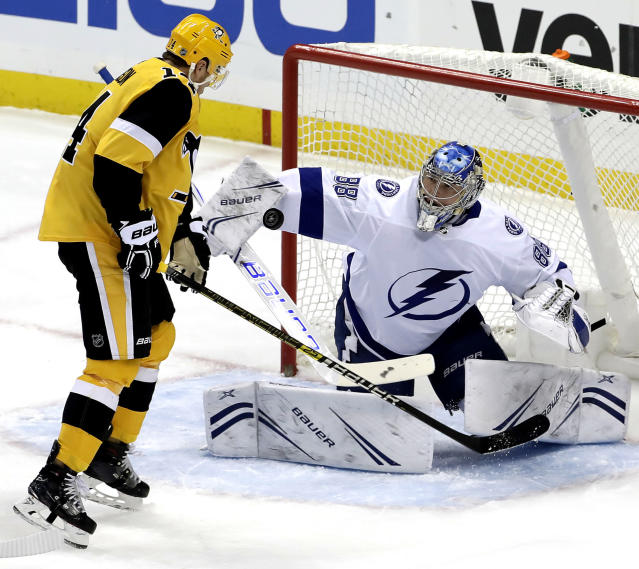 Tampa Bay Lightning goaltender Andrei Vasilevskiy (88) blocks a shot with Pittsburgh Penguins' Tanner Pearson (14) looking for the rebound during the first period of an NHL hockey game in Pittsburgh, Wednesday, Jan. 30, 2019. (AP Photo/Gene J. Puskar)