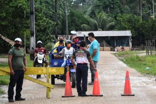Indigenous civil guards of the Ticuna ethnic group remain at the entrance of the Umariacu village, in Tabatinga, Amazonas state, Brazil, amid the new coronavirus pandemic
