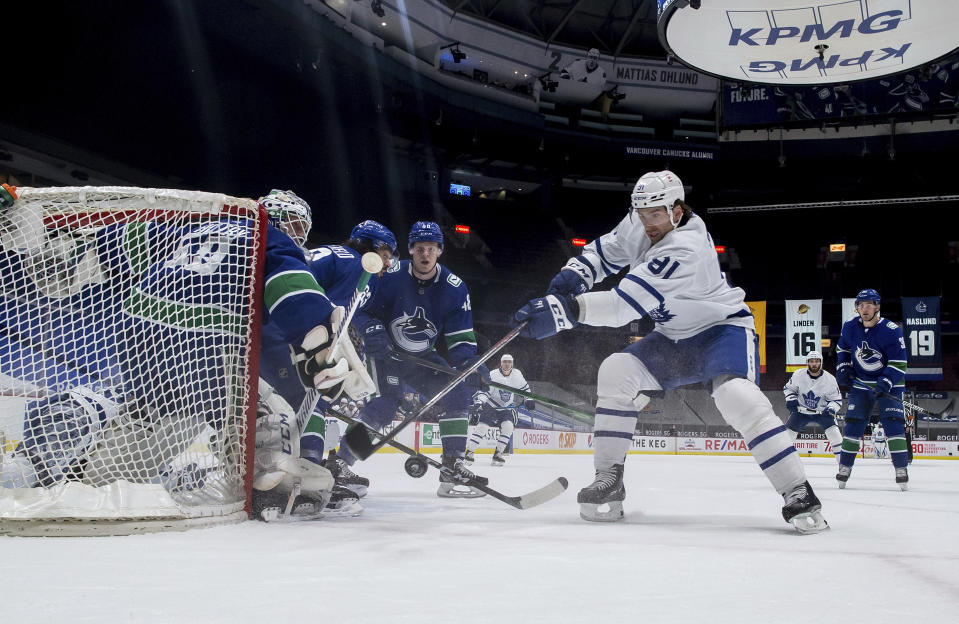 Toronto Maple Leafs' John Tavares (91) is stopped by Vancouver Canucks goalie Braden Holtby during the second period of an NHL hockey game Tuesday, April 20, 2021, in Vancouver, British Columbia. (Darryl Dyck/The Canadian Press via AP)