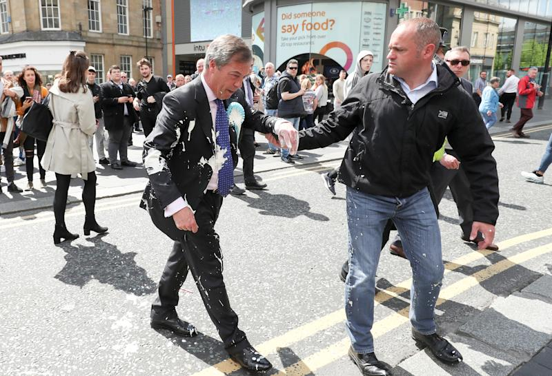 Man who threw milkshake at Farage admits assault and criminal damage