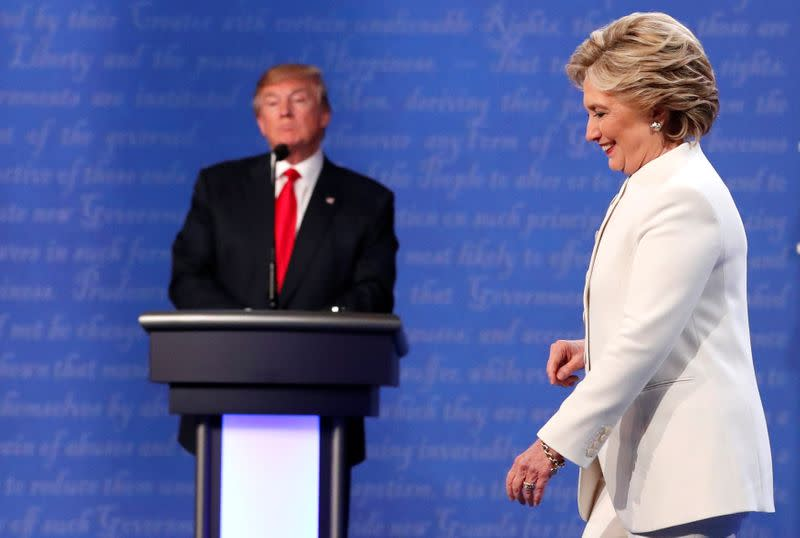 FILE PHOTO: Democratic U.S. presidential nominee Clinton walks off the debate stage as Republican U.S. presidential nominee Trump remains at his podium after the conclusion of their third and final 2016 presidential campaign debate in Las Vegas