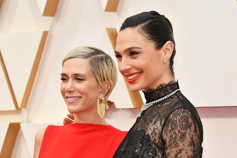 "HOLLYWOOD, CALIFORNIA - FEBRUARY 09: (L-R) Kristen Wiig and Gal Gadot of ""Wonder Woman 1984"" attend the 92nd Annual Academy Awards at Hollywood and Highland on February 09, 2020 in Hollywood, California. (Photo by Amy Sussman/Getty Images)"