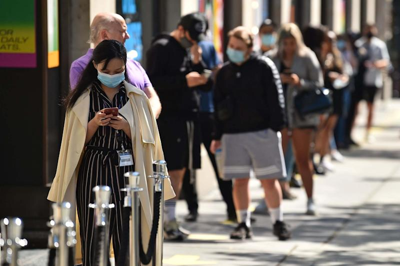 Customers queue outside Selfridges department store on Oxford Street in London on Monday: AFP via Getty Images