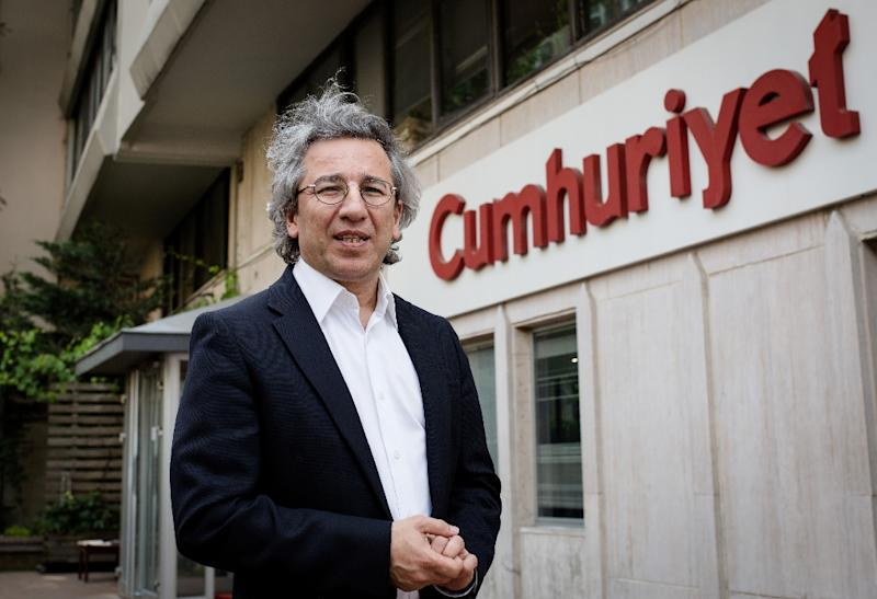 Cumhuriyet editor-in-chief Can Dundar poses outside the newspaper headquarters in Istanbul on June 3, 2015 (AFP Photo/Vedat Arik)