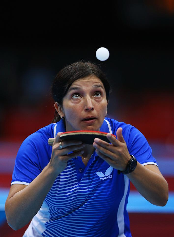 LONDON, ENGLAND - JULY 28:  Berta Rodriguez of Chile serves against Yuan Tian of Croatia during their Women's Singles Table Tennis match on Day 1 of the London 2012 Olympic Games at ExCeL on July 28, 2012 in London, England.  (Photo by Feng Li/Getty Images)