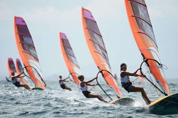 PHOTO: Competitors take part in the women's windsurfer race during the Tokyo 2020 Olympic Games sailing competition at the Enoshima Yacht Harbour in Fujisawa, Kanagawa Prefecture, Japan, on July 29, 2021. (Peter Parks/AFP via Getty Images)