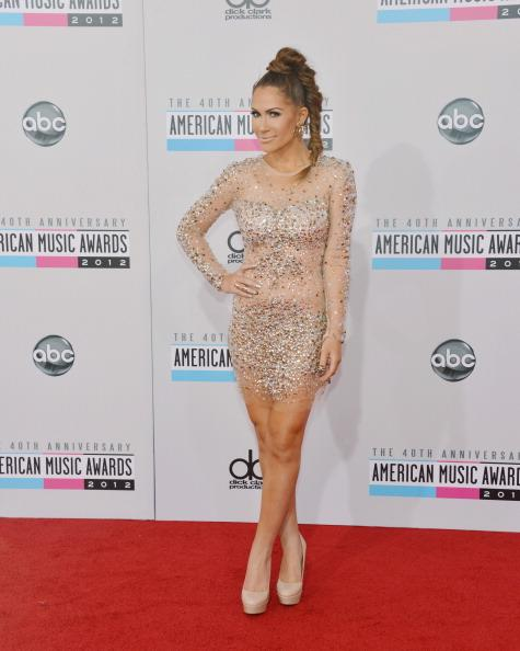 Kimberly Cole arrives on the 2012 American Music Awards red carpet.