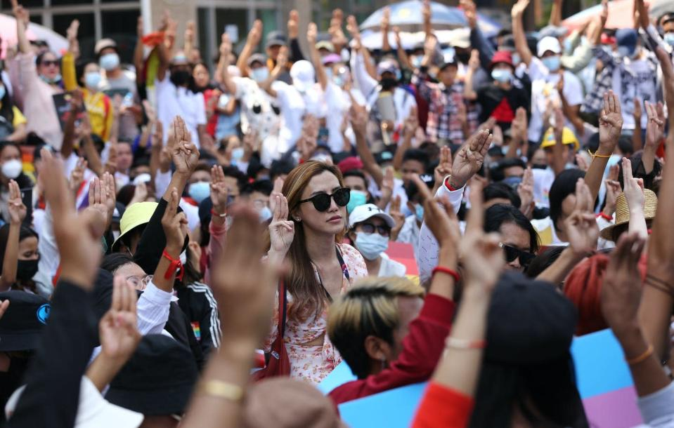 "<span class=""caption"">Anti-coup protesters flash the three-fingered salute during a rally in downtown Yangon, Myanmar on Feb. 19, 2021.</span> <span class=""attribution""><span class=""source"">(AP Photo)</span></span>"