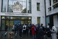 """Julian Assange supporters and members of the media queue up outside Westminster Magistrates Court to get a seat at his Bail hearing in London, Wednesday, Jan. 6, 2021. On Monday, Judge Vanessa Baraitser ruled that Julian Assange cannot be extradited to the US. because of concerns about his mental health. Assange had been charged under the US's 1917 Espionage Act for """"unlawfully obtaining and disclosing classified documents related to the national defence"""". Assange remains in custody, the US. has 14 day to appeal against the ruling. (AP Photo/Matt Dunham)"""