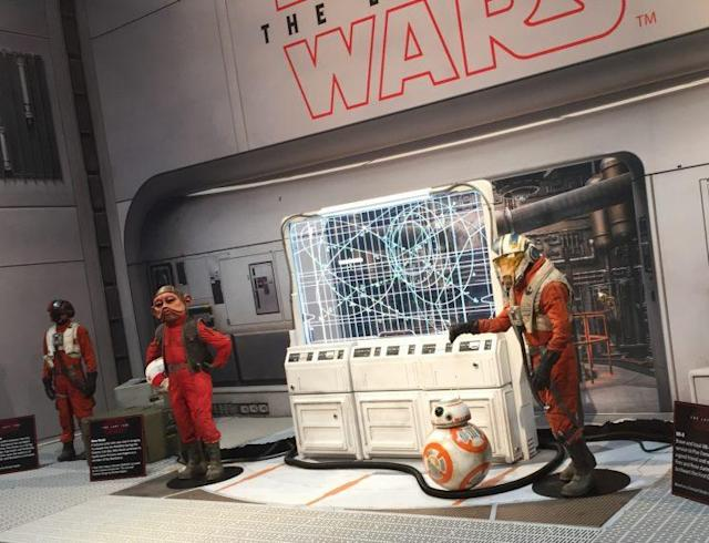 Poe Dameron's pilot costume (left) on exhibit alongside Nien Nunb, BB-8, and new character C'ai Threnalli. (Photo: Marcus Errico/Yahoo Movies)
