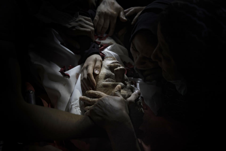 Relatives of Ahmad Saleh, 26, who was killed by Israeli gunfire on Thursday during a protest along the Israeli border, mourn over his body during his funeral in Jabaliya refugee camp, northern Gaza Strip, Friday, Sept. 3, 2021. (AP Photo/Khalil Hamra)