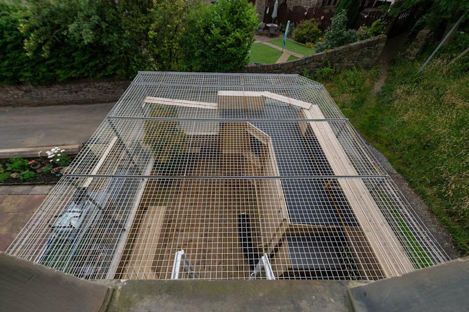 The cage for Sue Haworth's cats in Huddersfield, West Yorkshire (Picture: SWNS)