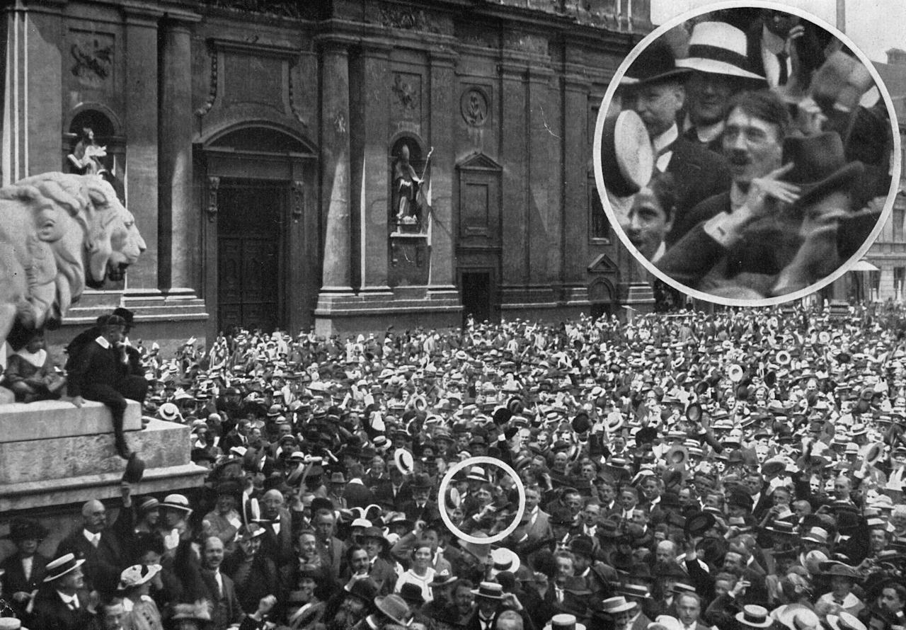 2nd August 1914:  High-angle view of a crowd gathered in the Odeon Platz in Munich, Germany. An inset shows future Nazi leader Adolf Hitler in the crowd.  (Photo by Heinrich Hoffmann/Hulton Archive/Getty Images)