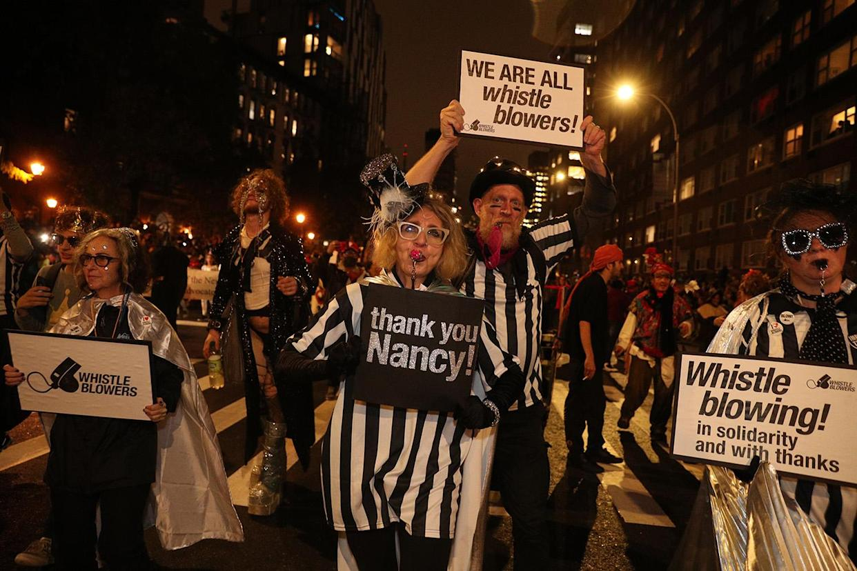People wear whistleblower costumes in the 46th annual Village Halloween Parade in New York City. (Photo: Gordon Donovan/Yahoo News)