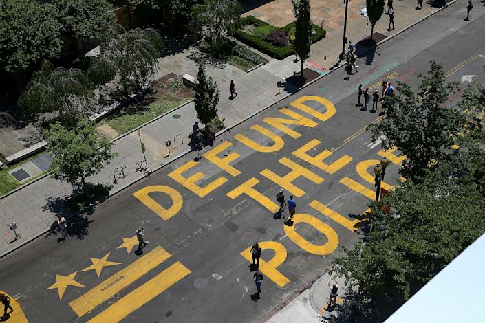 """Defund The Police"" was painted on the street near the White House in Washington, D.C.<span class=""copyright"">Tasos Katopodis—Getty Images</span>"