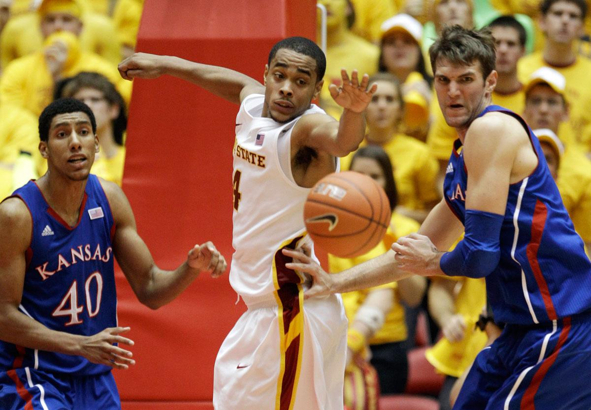 Iowa State guard Chris Allen, center, fights for a rebound with Kansas forward Kevin Young, left, and center Jeff Withey, right, during the first half of an NCAA college basketball game, Saturday, Jan. 28, 2012, in Ames, Iowa.  Kansas won 72-64.