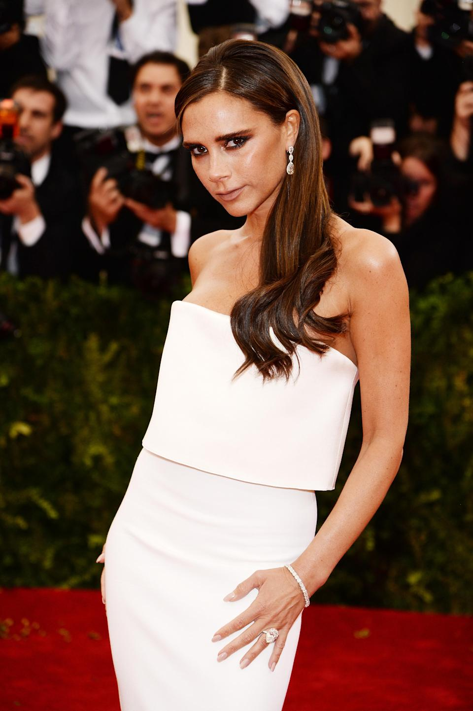 "<p>In 2017, Victoria Beckham penned a letter to her 18-year-old self for <a href=""https://www.vogue.co.uk/article/victoria-beckham-vogue-interview"" rel=""nofollow noopener"" target=""_blank"" data-ylk=""slk:British Vogue"" class=""link rapid-noclick-resp""><em>British Vogue</em></a> and revealed that she regretted having breast enlargement surgery. ""I should probably say, don't mess with your boobs,"" the fashion designer wrote. ""All those years I denied it – stupid. A sign of insecurity. Just celebrate what you've got."" <em>[Photo: Getty]</em> </p>"