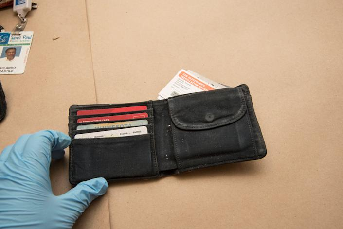 An investigator holds the wallet of Philando Castile.