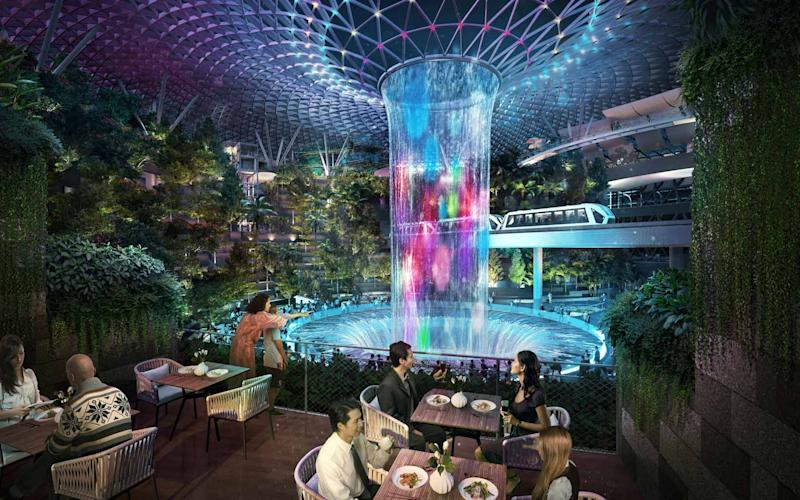 Jewel's 'rain vortex' is its indoor waterfall - changi airport