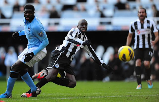 NEWCASTLE UPON TYNE, ENGLAND - DECEMBER 15: Newcastle forward Demba Ba gets in a shot at goal during the Barclays Premier League match between Newcastle United and Manchester City at St James' Park on December 15, 2012 in Newcastle upon Tyne, England. (Photo by Stu Forster/Getty Images)