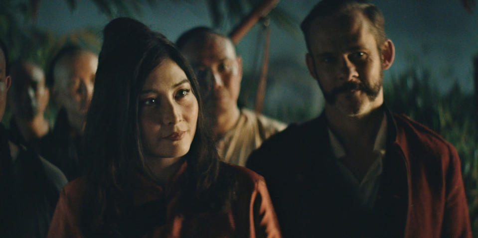 """This image released by Samuel Goldwyn Films shows Josie Ho, left, and Dominic Monaghan in a scene from """"Edge of the World."""" (Samuel Goldwyn Films via AP)"""