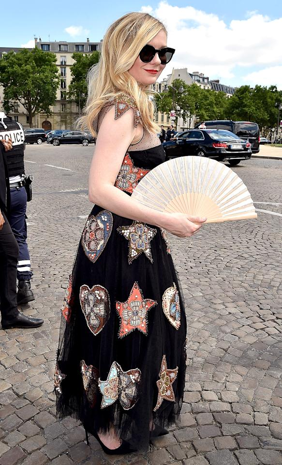 "<p>The <a rel=""nofollow"" rel=""nofollow"" href=""https://www.yahoo.com/celebrity/kirsten-dunst-jesse-plemons-engaged-224000271.html"">engaged actress</a> caused great fanfare at the Christian Dior presentation in a colorful frock. (Photo: Jacopo Raule/GC Images) </p>"