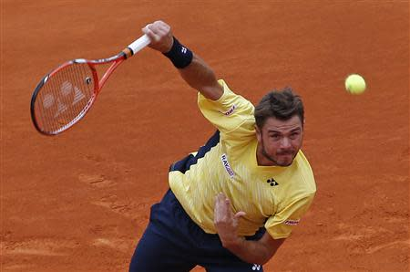 Stanislas Wawrinka of Switzerland serves to Marin Cilic of Croatia during the Monte Carlo Masters in Monaco April 16, 2014. REUTERS/Eric Gaillard
