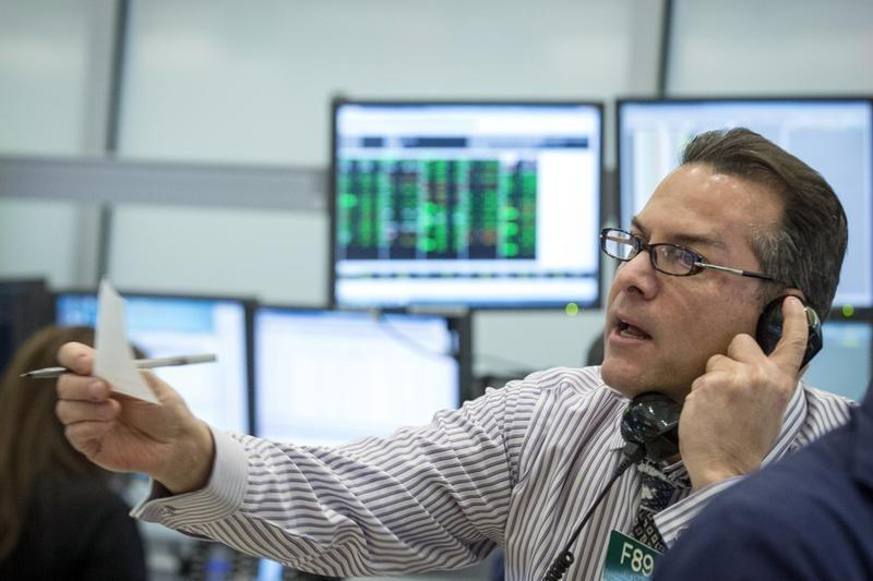 A NYSE Amex options trader works at the New York Stock Exchange