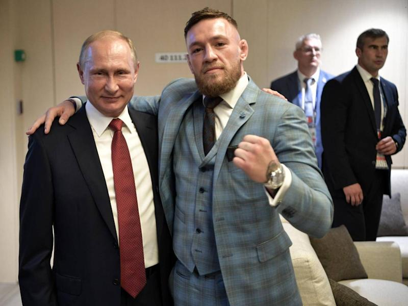 Russia president Vladimir Putin poses for a picture with UFC star Conor McGregor (EPA)