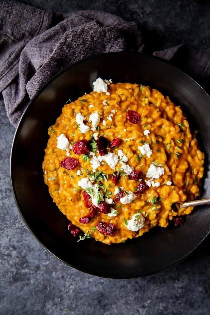 """<p>Creamy pumpkin pairs well with tangy goat cheese and sweet cranberries for a flavor profile that says """"It's fall, y'all!""""</p><p><strong>Get the recipe at <a href=""""https://www.platingsandpairings.com/pumpkin-risotto-with-goat-cheese-dried-cranberries/"""" rel=""""nofollow noopener"""" target=""""_blank"""" data-ylk=""""slk:Platings & Pairings"""" class=""""link rapid-noclick-resp"""">Platings & Pairings</a>.</strong> </p>"""