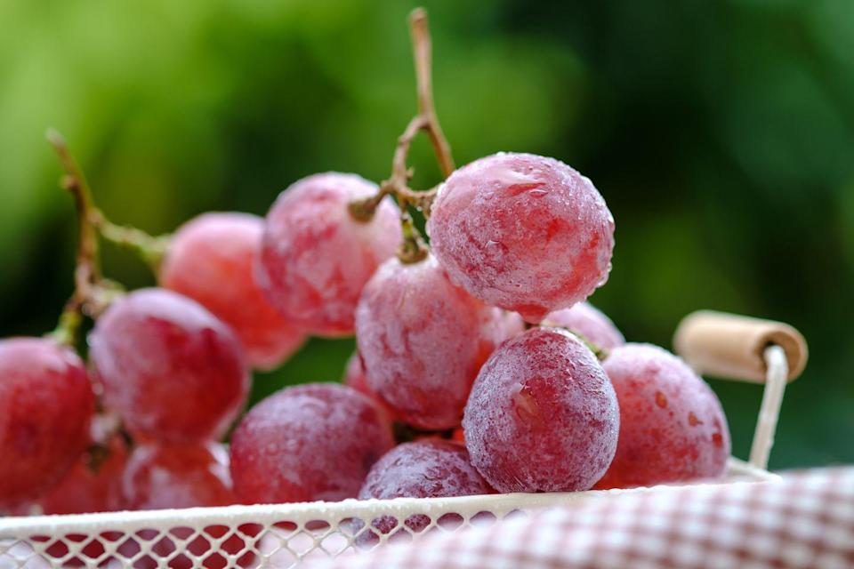 """<p>""""<strong>One cup of grapes clocks in at just under 70 calories and fits into any lifestyle goals, including weight loss.</strong> This is the perfect option for when you're craving something cold and sweet. Plus, frozen grapes take a little bit longer to chew - this might help you slow down while you eat to promote mindfulness and tune into our natural hunger and fullness cues,"""" Zhu adds.</p>"""