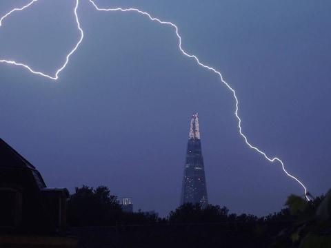Lightning lights up the sky over The Shard in central London on Saturday - Credit: @samueltwilkinson/PA