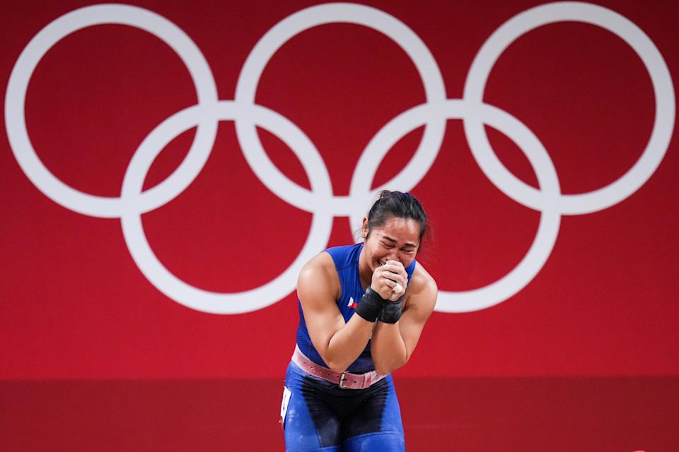 Hidilyn Diaz of the Philippines cries after winning the women's 55kg weightlifting gold at the Tokyo Olympics.