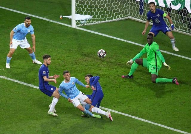 Andreas Christensen (centre) blocks a shot from Phil Foden